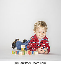 Boy playing with blocks.