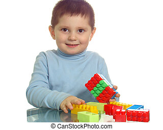 Boy playing with colorful bricks smiling