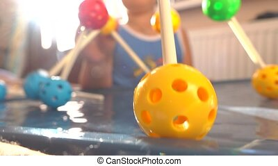Boy playing with colorful plastic construction set. Balls...