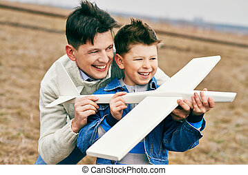 Boy playing with father