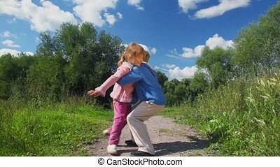 boy playing with girl outdoor