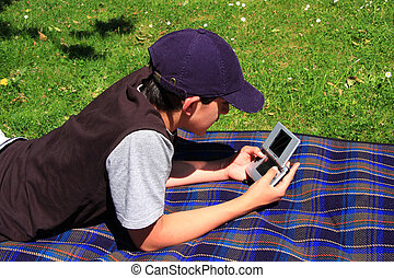 Boy playing with his console game