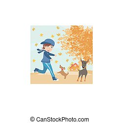 boy playing with his dogs in autumn