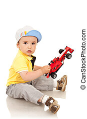 boy playing with his toy car
