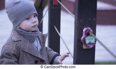 Boy playing with padlocks