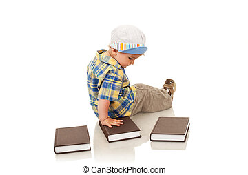boy playing with some books