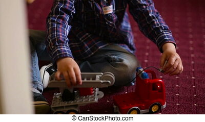 boy playing with the constructor. DOLLY HD