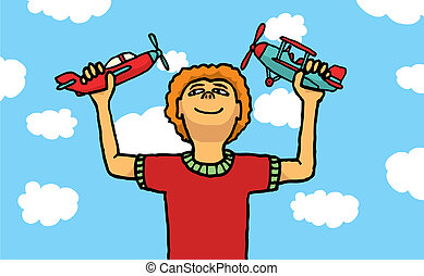 Boy playing with toy planes