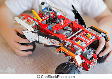 boy plays collects from the constructor of car - A boy plays...
