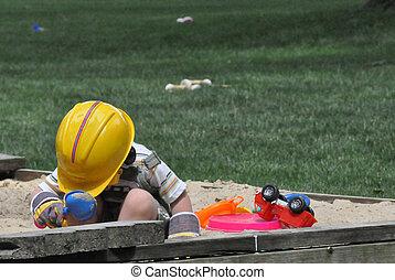 Boy Plays in Sandbox