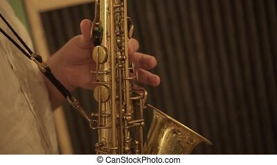 Boy plays the saxophone with his hands
