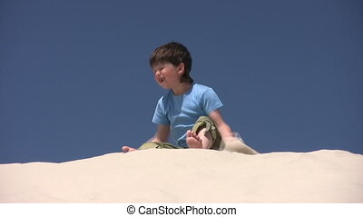 Boy plays with the sand