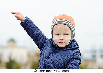 boy pointing on the left