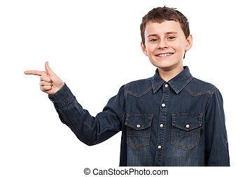 Boy pointing to the side of the image