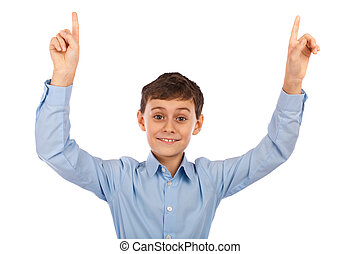 Boy pointing with both hands to the copyspace above