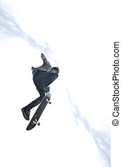 Boy practicing skate in a skate park - isolated