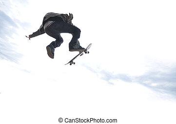 Boy practicing skate in a skate park