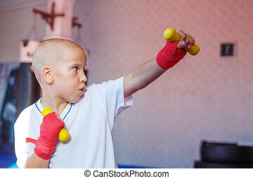 boy practicing strikes training in the gym