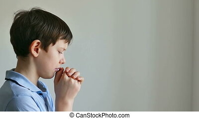 Boy prayer - Boy  teenager praying belief in god