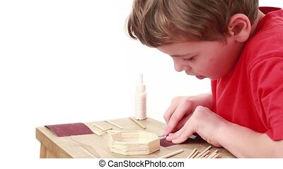 Boy prepare next stick for construction of match house