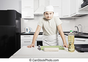 Boy prepared to cook