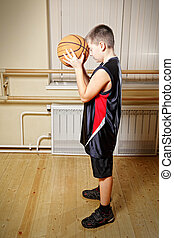 Boy preparing throw basketball
