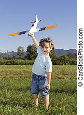 Boy preparing to launch RC plane