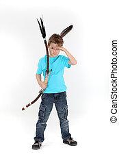 Boy pretending to be an Indian warrior