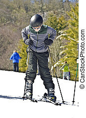 Boy Putting on Skis