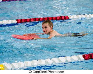 Boy racing in triathlon