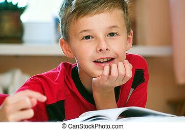 Boy reading book portrait - Portrait of young boy reading...