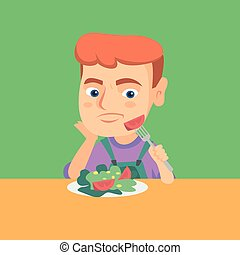 Boy refusing to eat salad with healthy vegetables.