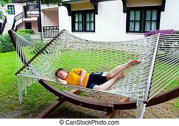 Boy resting in a hammock