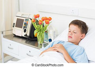 Boy resting in hospital bed