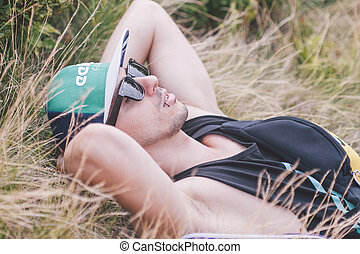 boy resting in the grass