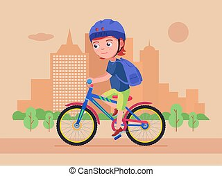 Boy rides a bike in the park