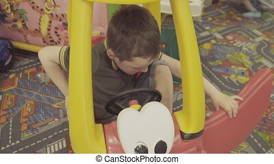 boy riding a car