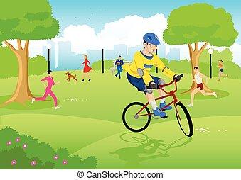 Boy riding bicycle at city park