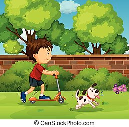 Boy riding on scooter in the yard