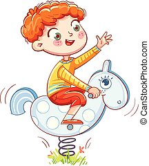 Boy riding on the spring rocking-horse