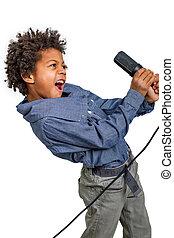 Boy rocker. - Little rocker emotionally singing into a...