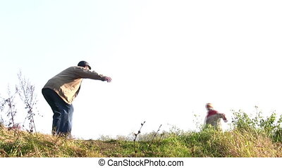 boy run to senior in autumn park