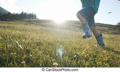 Boy Running Against Sundown