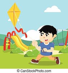boy running and playing kite
