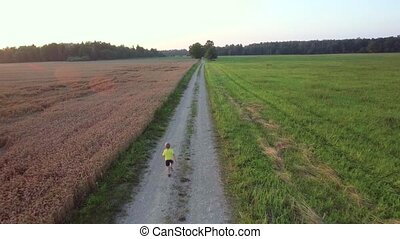 boy running in fields