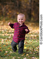 Boy running in leaves