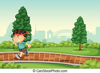 Boy running in park