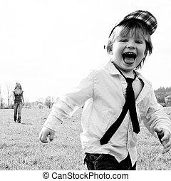 boy running meadow - boy two years running in the meadow ...