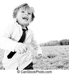 boy running meadow - boy two years running in the meadow....