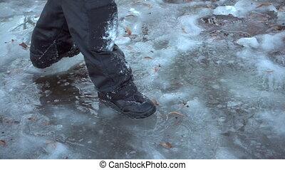 Boy running on thin ice, slow motion